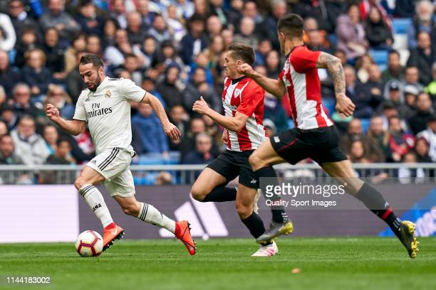 Dani Carvajal of Real Madrid CF battle for the ball with Yuri Berchiche and Iñigo Cordoba of Athletic Club during the La Liga match between Real...