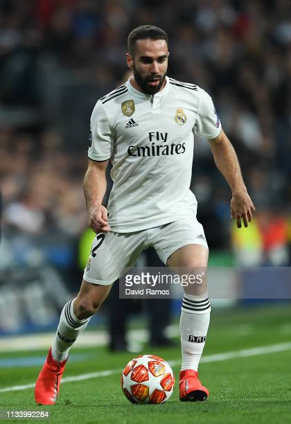 Dani Carvajal of Real Madrid CF runs with the ball during the UEFA Champions League Round of 16 Second Leg match between Real Madrid and Ajax at...