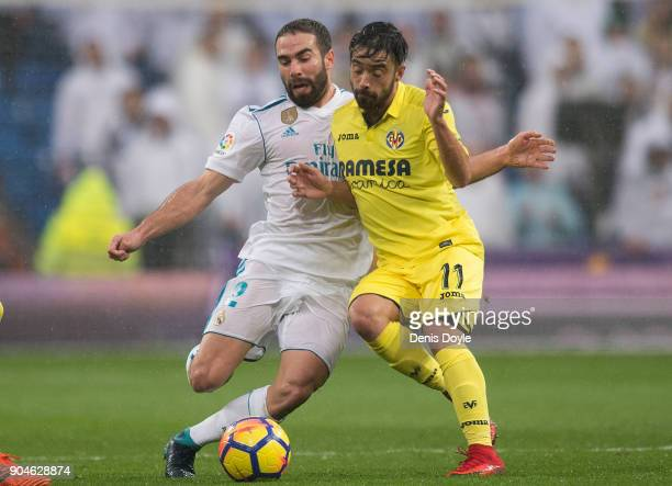 Dani Carvajal of Real Madrid clashes with Jaume Costa of Villarreal CF during the La Liga match between Real Madrid and Villarreal at Estadio...
