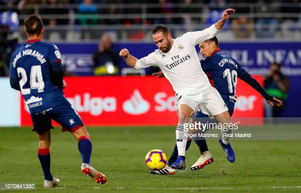 Dani Carvajal of Real Madrid competes for the ball with Chimy Avila of SD Huesca during the La Liga match between SD Huesca and Real Madrid CF at...