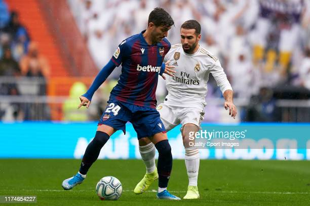 Dani Carvajal of Real Madrid competes for the ball with Jose Gomez Campana of Levante UD during the La Liga match between Real Madrid CF and Levante...