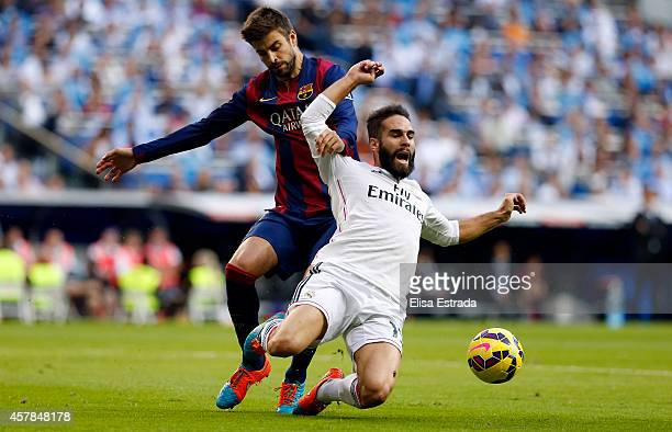 Dani Carvajal of Real Madrid fights for the ball with Gerard Pique of Barcelona during the La Liga match between Real Madrid CF and FC Barcelona at...