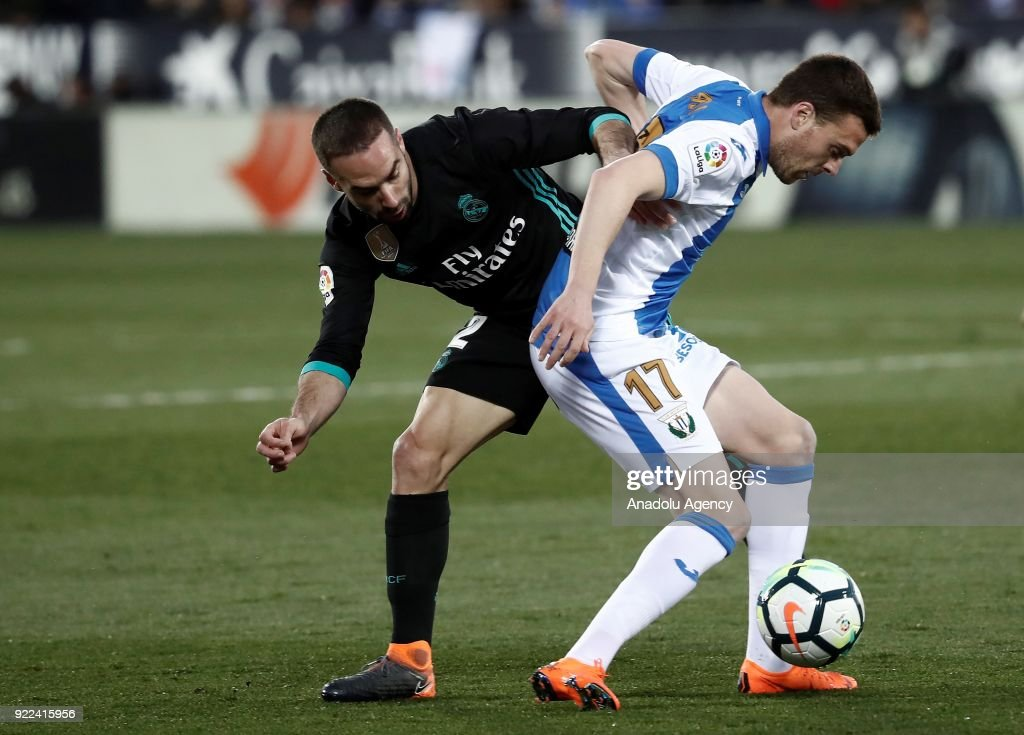 Dani Carvajal of Real Madrid in action against Javi Eraso of Leganes during the La Liga football match between Leganes and Real Madrid at the Estadio Municipal Butarque in Madrid, Spain on February 21, 2018.