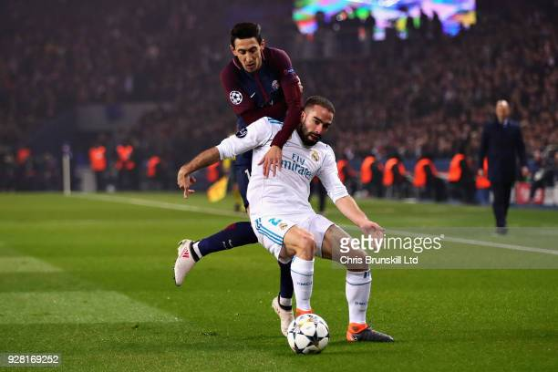 Dani Carvajal of Real Madrid is challenged by Angel Di Maria of Paris SaintGermain during the UEFA Champions League Round of 16 Second Leg match...