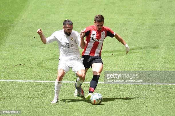 Dani Carvajal of Real Madrid is challenged by Inigo Cordoba of Athletic Club during the La Liga match between Athletic Club and Real Madrid CF at San...