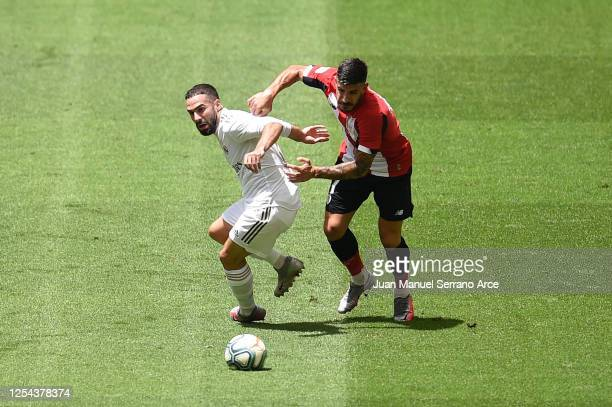 Dani Carvajal of Real Madrid is challenged by Yuri Berchiche of Athletic Club during the La Liga match between Athletic Club and Real Madrid CF at...