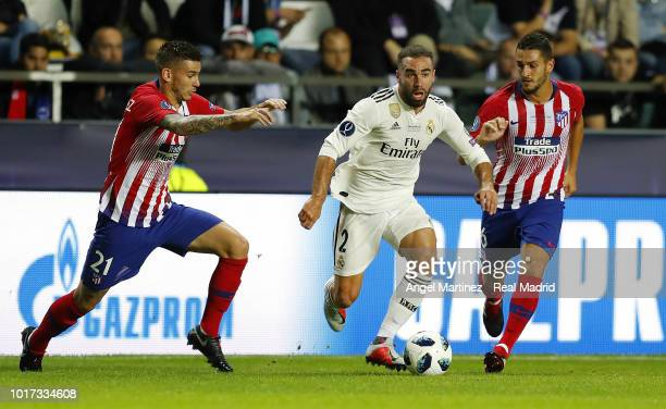 Dani Carvajal of Real Madrid is chased by Lucas Hernandez and Koke of Atletico de Madrid during the UEFA Super Cup match between Real Madrid and...