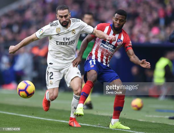 Dani Carvajal of Real Madrid tackles Thomas Lemar of Club Atletico de Madrid during the La Liga match between Club Atletico de Madrid and Real Madrid...