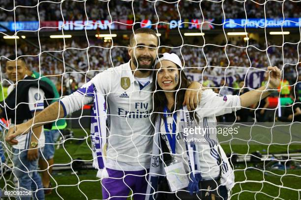 Dani Carvajal of Real Madrid with the girlfriend celebrating behind the goal network during the UEFA Champions League Final between Juventus and Real...