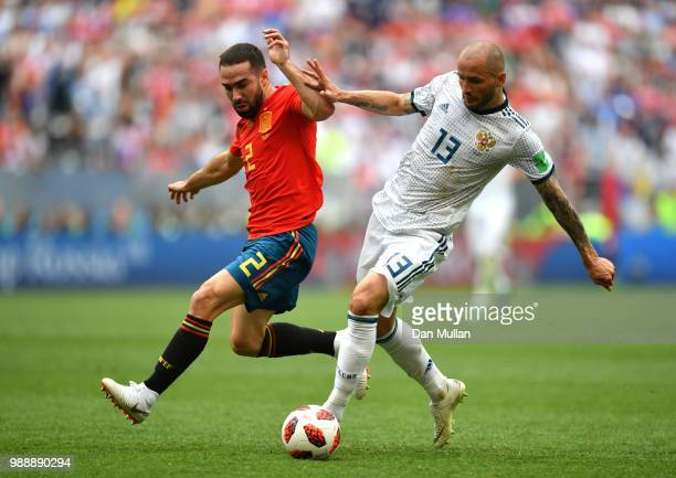 Dani Carvajal of Spain and Fedor Kudriashov of Russia battle for the ball during the 2018 FIFA World Cup Russia Round of 16 match between Spain and...
