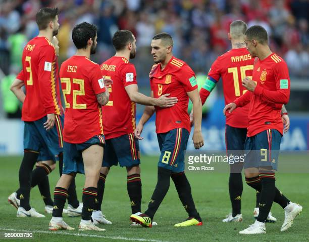 Dani Carvajal of Spain and Koke of Spain look dejected following their sides defeat in the 2018 FIFA World Cup Russia Round of 16 match between Spain...