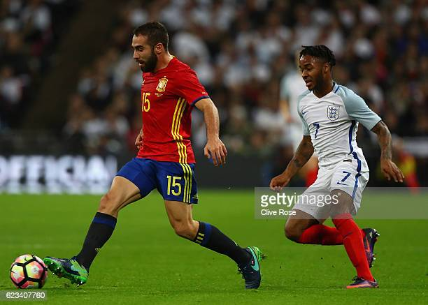 Dani Carvajal of Spain evades Raheem Sterling of England during the international friendly match between England and Spain at Wembley Stadium on...