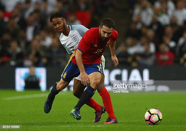 Dani Carvajal of Spain holds off the challenge of Raheem Sterling of England during the international friendly match between England and Spain at...