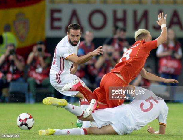 Dani Carvajal of Spain in action against Egzijan Aliovskiv of Macedonia during the FIFA 2018 World Cup Qualifiers Group G match between Macedonia and...