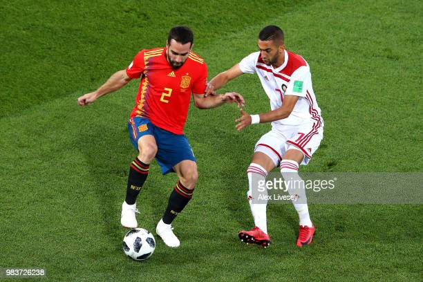 Dani Carvajal of Spain is challenged by Hakim Ziyach of Morocco during the 2018 FIFA World Cup Russia group B match between Spain and Morocco at...