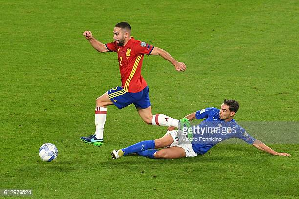 Dani Carvajal of Spain is tackled by Mattia De Sciglio of Italy during the FIFA 2018 World Cup Qualifier between Italy and Spain at Juventus Stadium...