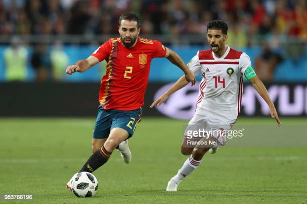 Dani Carvajal of Spain runs with the ball under pressure from Mbark Boussoufa of Morocco during the 2018 FIFA World Cup Russia group B match between...