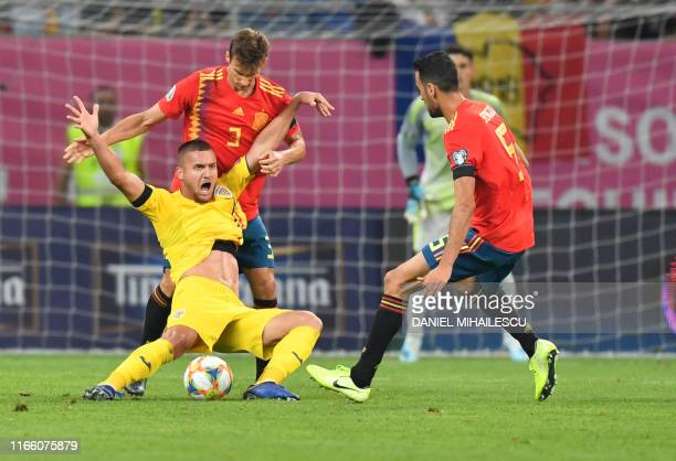 Dani Carvajal of Spain vies for the ball with George Puscas of Romania during the Euro 2020 football qualification match between Romania and Spain in...