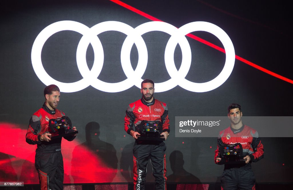 Dani Carvajal (centre) Sergio Ramos (left) and Marco Asensio of Real Madrid pose on the podium after coming 1st, 2nd and 3rd respectively during the simulated Formula e race before being presented with new Audi cars as part of an ongoing sponsorship deal with Real Madrid at their Ciudad Deportivo training grounds on November 23, 2017 in Madrid, Spain.