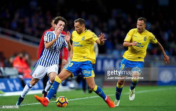 Dani Castellano of UD Las Palmas duels for the ball with Alvaro Odriozola of Real Sociedad during the La Liga match between Real Sociedad de Futbol...