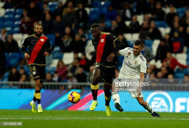 Dani Ceballos and Luis Advincula are seen in action during the La Liga football match between Real Madrid and Rayo Vallecano at the Estadio Santiago...