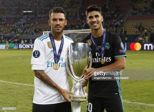 Dani Ceballos and Marco Asensio of Real Madrid pose with the trophy after the UEFA Super Cup match between Real Madrid and Manchester United at...