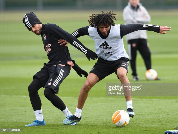 Dani Ceballos and Mohamed Elneny of Arsenal during the Arsenal training session at London Colney on April 07, 2021 in St Albans, England.