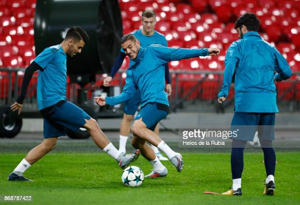 Dani Ceballos and Theo Hernandez of Real Madrid warms up during a training sessions at Wembley Stadium on October 31 2017 in London England