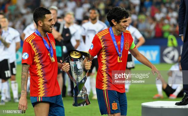 Dani Ceballos, Jesús Vallejo of Spain with the trophy after the 2019 UEFA U-21 Final between Spain and Germany at Stadio Friuli on June 30, 2019 in...
