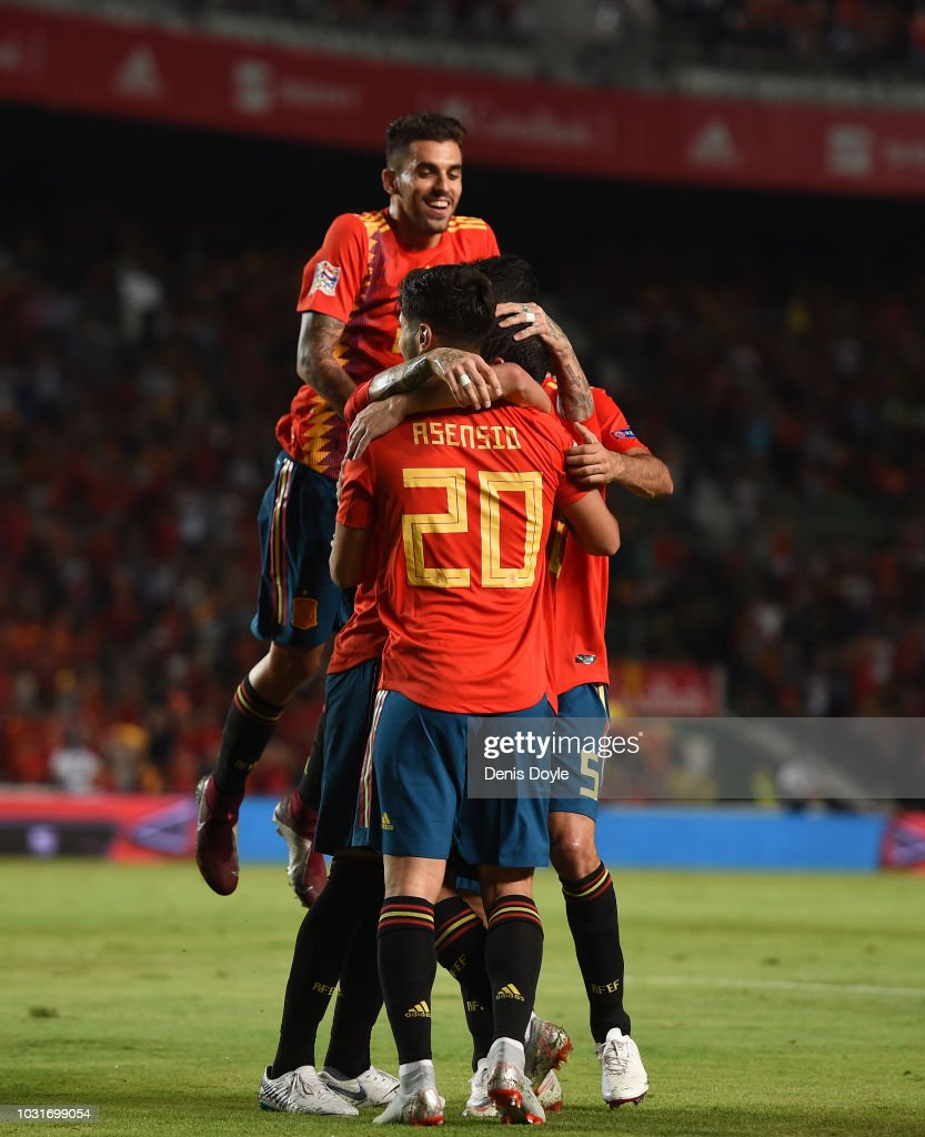 Dani Ceballos jumps on top of Sergio Ramos (unseen) and Marco Asensio after Ramos' scored Spain's 5th goal during the UEFA Nations League A group four match between Spain and Croatia at Estadio Manuel Martinez Valero on September 11, 2018 in Elche, Spain.