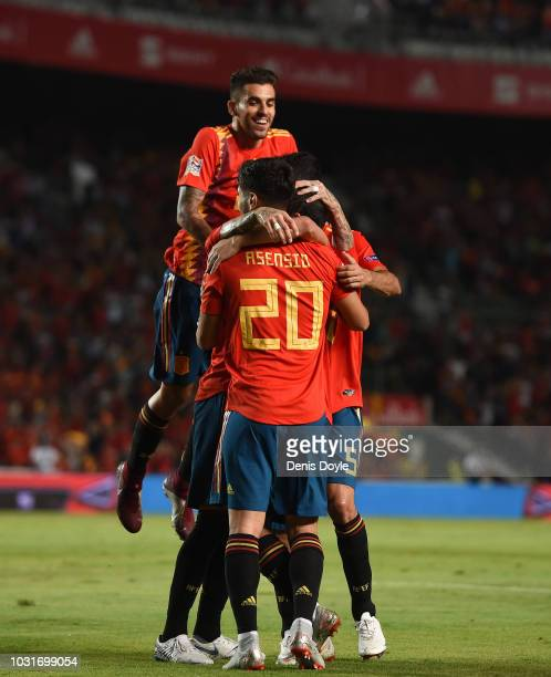 Dani Ceballos jumps on top of Sergio Ramos and Marco Asensio after Ramos' scored Spain's 5th goal during the UEFA Nations League A group four match...