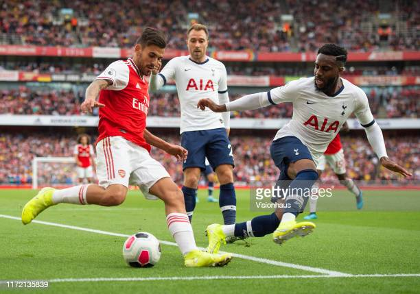 Dani Ceballos of Arsenal and Danny Rose and Christian Eriksen of Tottenham Hotspur during the Premier League match between Arsenal FC and Tottenham...