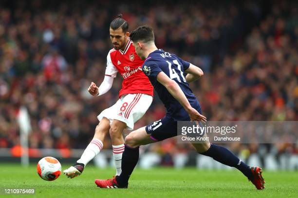 Dani Ceballos of Arsenal and Declan Rice of West Ham United in action during the Premier League match between Arsenal FC and West Ham United at...