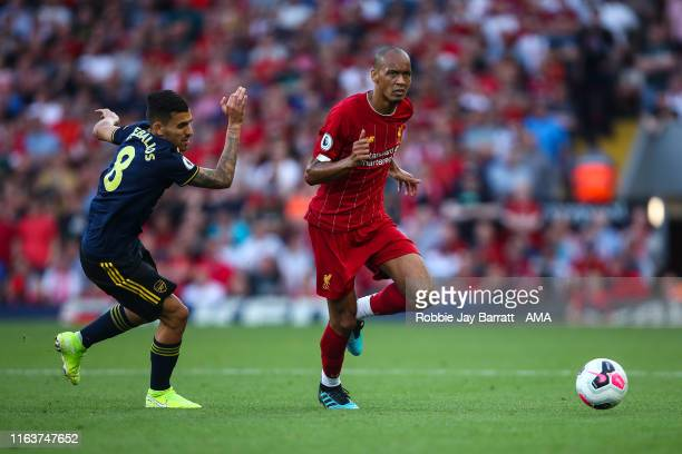 Dani Ceballos of Arsenal and Fabinho of Liverpool during the Premier League match between Liverpool FC and Arsenal FC at Anfield on August 24 2019 in...