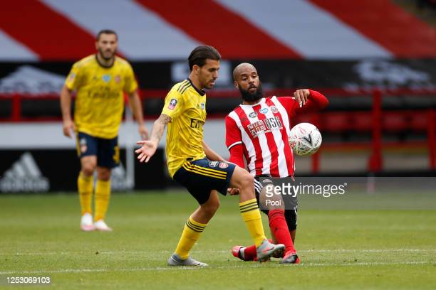 Dani Ceballos of Arsenal battles for possession with David McGoldrick of Sheffield United during the FA Cup Fifth Quarter Final match between...