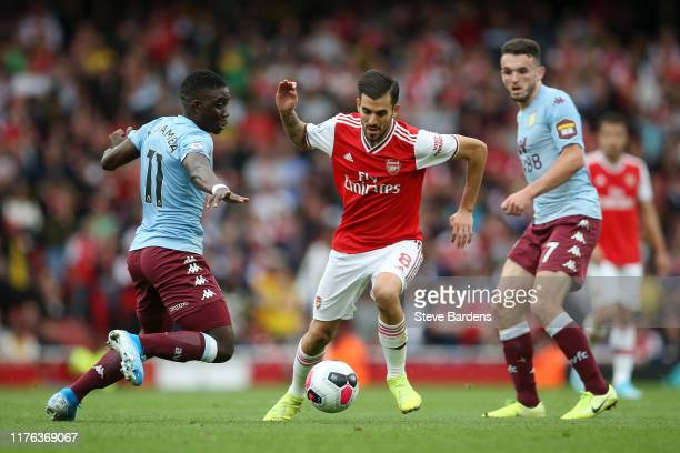 Dani Ceballos of Arsenal breaks away from Aston Villa defenders during the Premier League match between Arsenal FC and Aston Villa at Emirates...