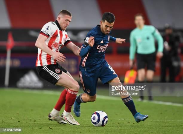 Dani Ceballos of Arsenal breaks past John Lundstram of Sheffield United during the Premier League match between Sheffield United and Arsenal at...