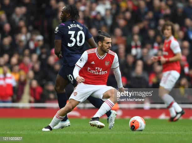 Dani Ceballos of Arsenal breaks past Michail Antonio of West Ham during the Premier League match between Arsenal FC and West Ham United at Emirates...