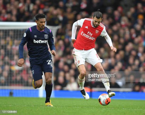 Dani Ceballos of Arsenal breaks past Sebastien Haller of West Ham during the Premier League match between Arsenal FC and West Ham United at Emirates...