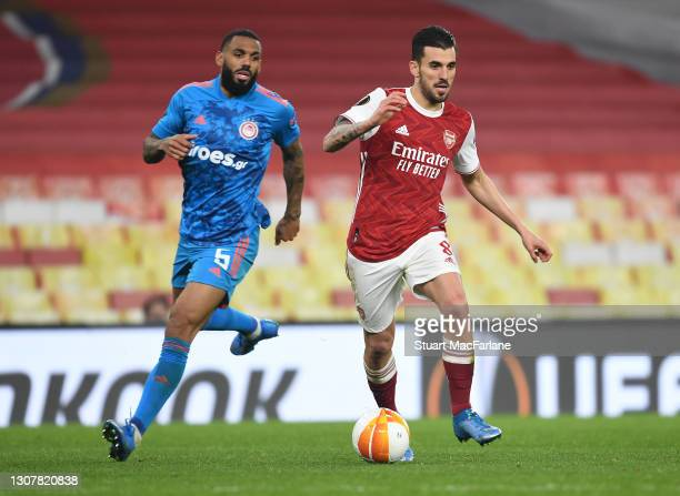 Dani Ceballos of Arsenal breaks past Yann M'Vila of Olympiacos during the UEFA Europa League Round of 16 Second Leg match between Arsenal and...