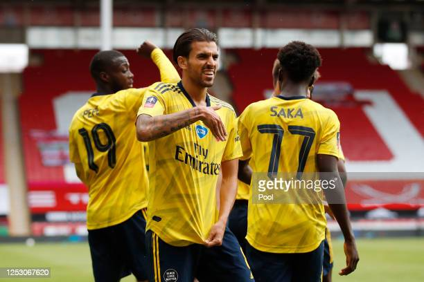 Dani Ceballos of Arsenal celebrates with his team after scoring his teams second goal during the FA Cup Fifth Quarter Final match between Sheffield...