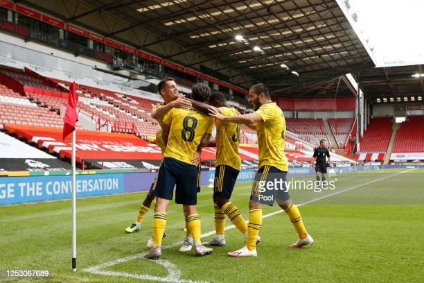 Dani Ceballos of Arsenal celebrates with his team with his team after scoring his teams second goal during the FA Cup Fifth Quarter Final match...
