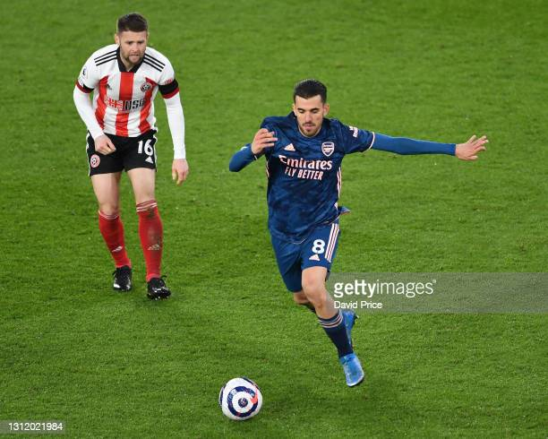 Dani Ceballos of Arsenal drives away from Oliver Norwood of Sheffield United during the Premier League match between Sheffield United and Arsenal at...