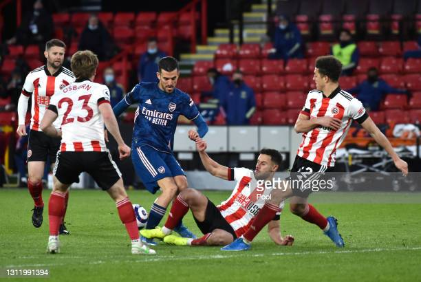 Dani Ceballos of Arsenal is challenged by George Baldock of Sheffield United during the Premier League match between Sheffield United and Arsenal at...