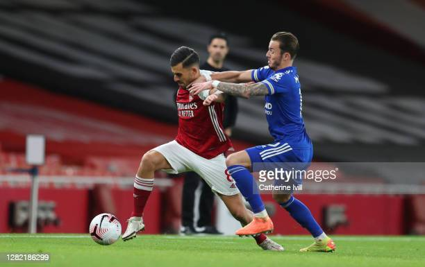 Dani Ceballos of Arsenal is challenged by James Maddison of Leicester City during the Premier League match between Arsenal and Leicester City at...