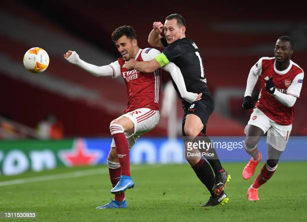 Dani Ceballos of Arsenal is challenged by Jan Boril of Slavia during the UEFA Europa League Quarter Final First Leg match between Arsenal FC and...