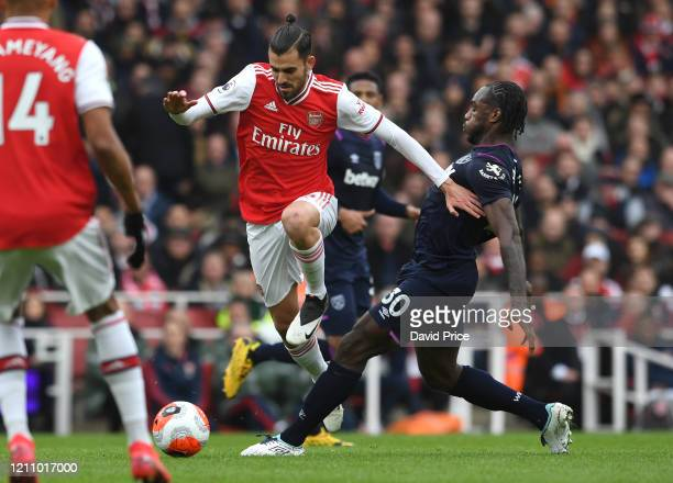 Dani Ceballos of Arsenal jumps the challenge from Michail Antonio of West Ham during the Premier League match between Arsenal FC and West Ham United...