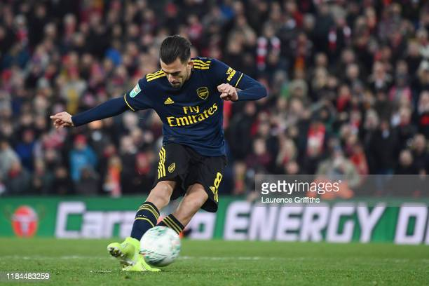 Dani Ceballos of Arsenal misses his sides fourth penalty during the penalty shoot out during the Carabao Cup Round of 16 match between Liverpool and...