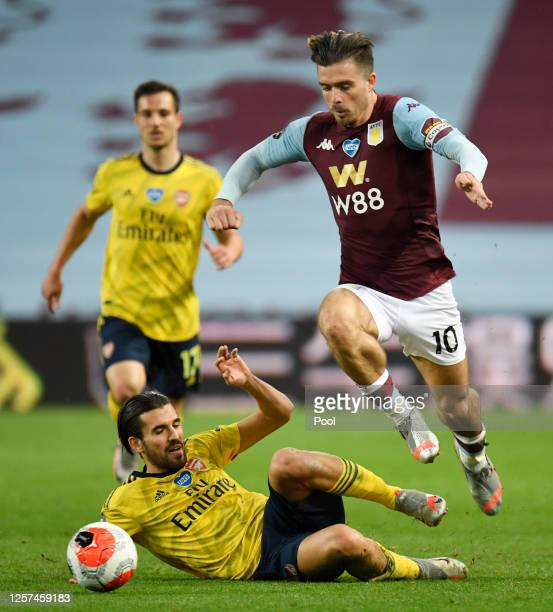 Dani Ceballos of Arsenal tackles Jack Grealish of Aston Villa during the Premier League match between Aston Villa and Arsenal FC at Villa Park on...