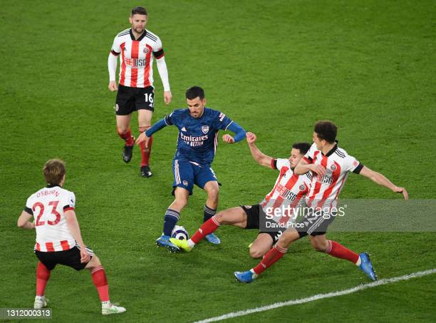 Dani Ceballos of Arsenal takes on George Baldock and Ethan Ampadu of Sheffield United during the Premier League match between Sheffield United and...